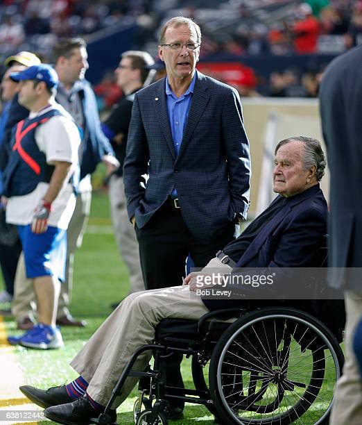 Former President George HW Bush right along with Neil Bush prior to the AFC Wild Card game at NRG Stadium on January 7 2017 in Houston Texas n