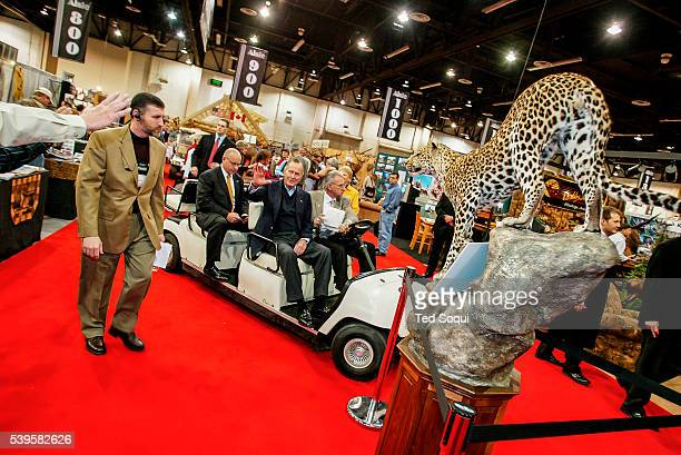 Former President George HW Bush touring the convention floor The Safari Hunters Club convention 2004 held in Reno Nevada The annual event features...