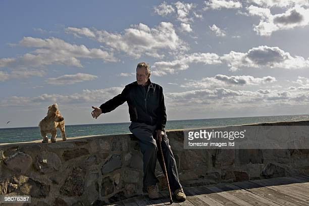Former President George HW Bush with pet dog Bibi during a portrait session for Parade Magazine at home in Kennebunkport Maine on September 29 2009