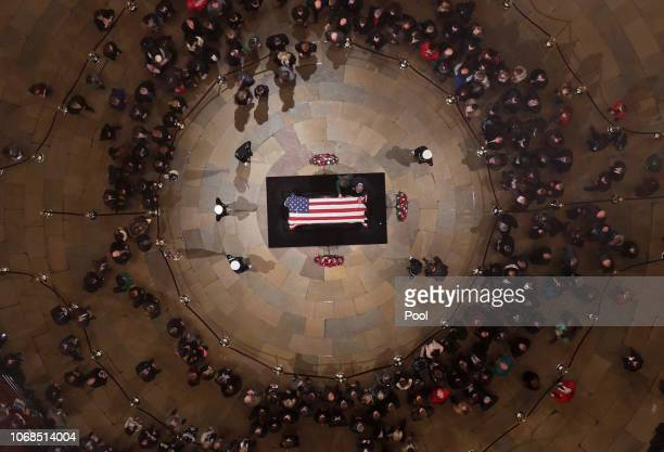 Former President George W Bush and first lady Laura Bush put their hands on the flagdraped casket of the late former President George HW Bush as he...