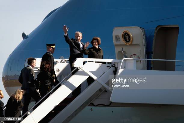 Former President George W Bush and his wife Laura board a flight with the remains of his father President George HW Bush for a flight to Washington D...