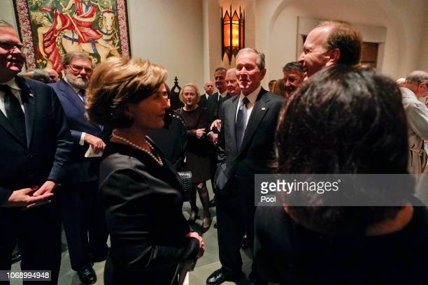 Former President George W Bush and Laura Bush talk with Neil Bush and his wife Maria right after a funeral service for former President George HW...