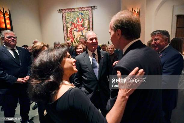 Former President George W Bush and Laura Bush talk with Neil Bush and his wife Maria front left after a funeral service for former President George...
