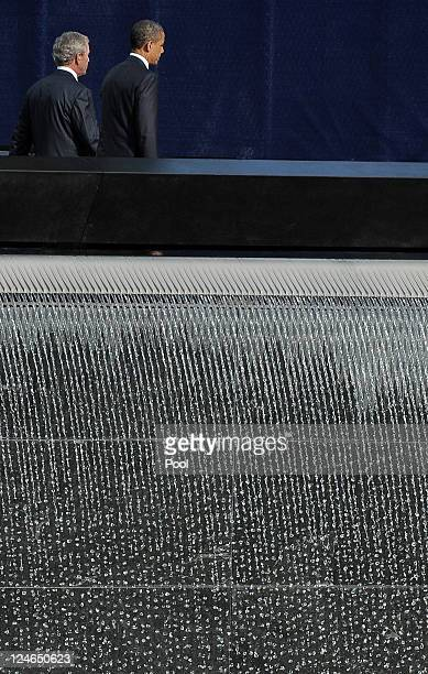 Former President George W Bush and President Barack Obama walk past the North Pool of the 9/11 Memorial during the tenth anniversary ceremonies of...