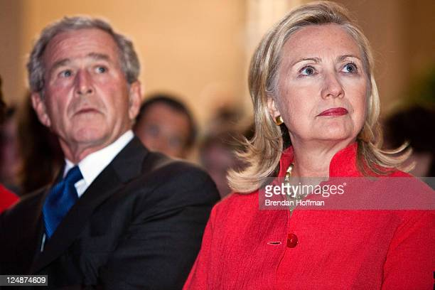 Former President George W Bush and Secretary of State Hillary Clinton watch a video at the Summit to Save Lives on September 13 2011 in Washington DC...