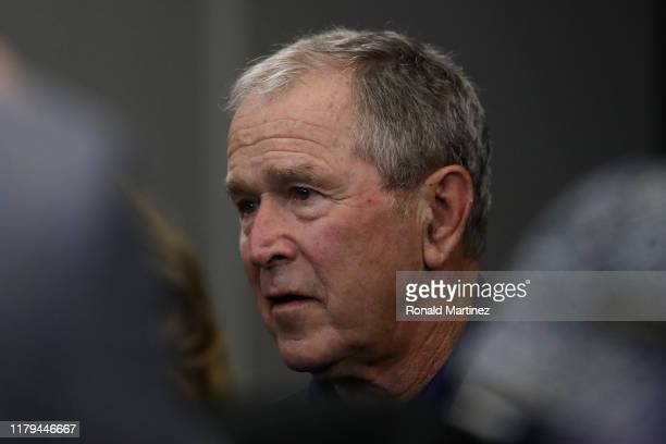 Former President George W Bush attends the NFL game between the Dallas Cowboys and the Green Bay Packers at ATT Stadium on October 06 2019 in...