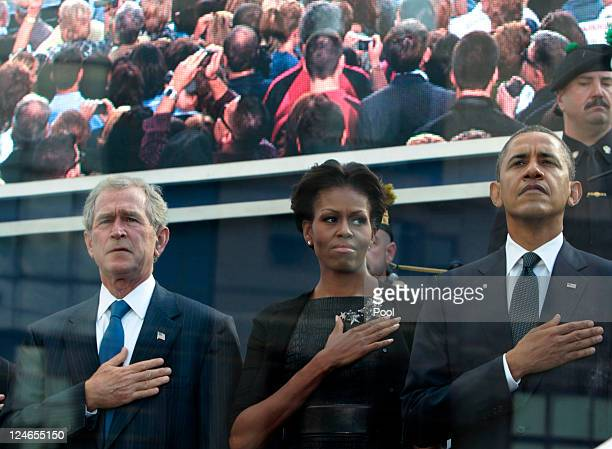 Former President George W Bush first lady Michelle Obama and President Barack Obama attend the tenth anniversary ceremonies of the September 11 2001...