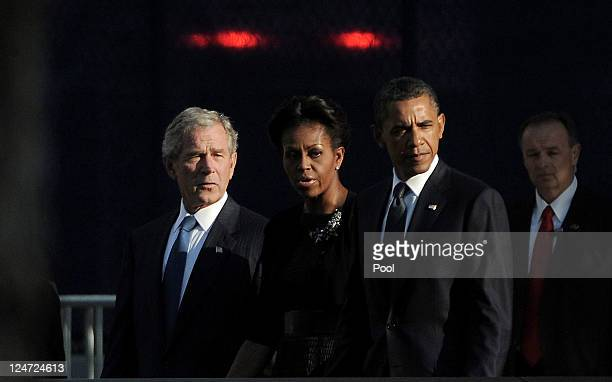 Former President George W Bush First Lady Michelle Obama and President Barack Obama the North Pool of the 9/11 Memorial during the tenth anniversary...