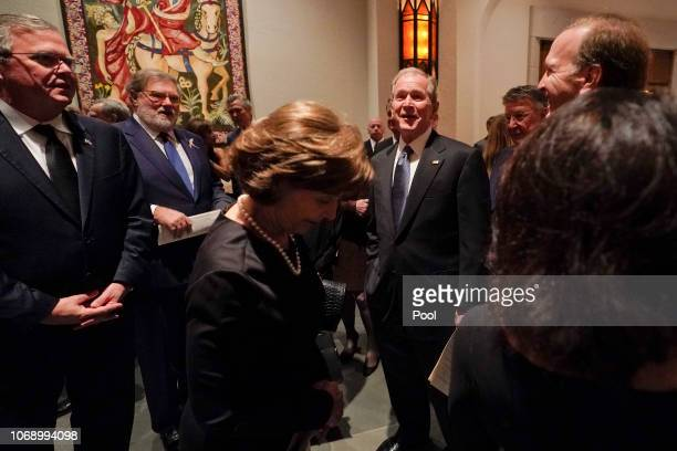 Former President George W Bush Laura Bush front Jeb Bush left and Neil Bush right after a funeral service for former President George HW Bush at St...
