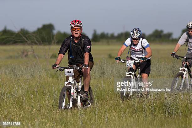 Former President George W Bush leads a pack of bicycle riders through his Prairie Chapel Ranch outside Crawford Texas in the fourth annual Wounded...