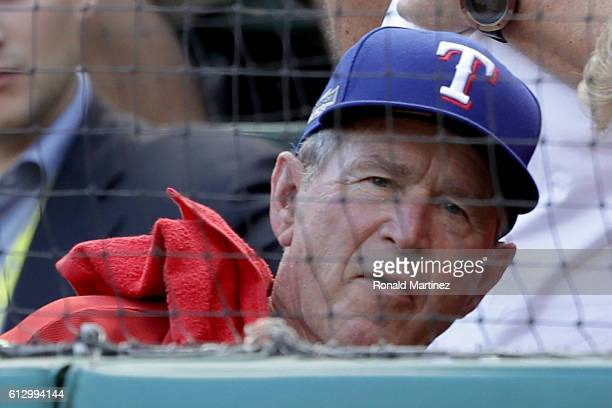 Former President George W Bush looks on during game one of the American League Divison Series between the Toronto Blue Jays and the Texas Rangers at...
