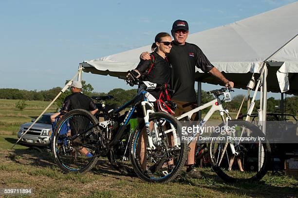 Former President George W Bush poses with Melissa Stockwell as he hosts bicycle riders through his Prairie Chapel Ranch outside Crawford Texas in the...