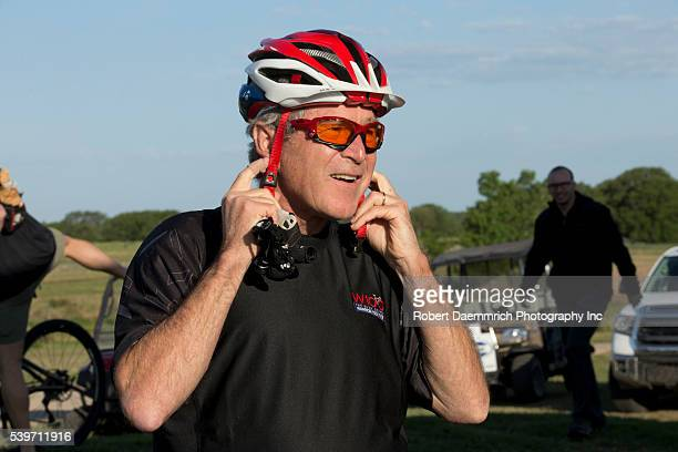 Former President George W Bush readies his headgear before leading a pack of bicycle riders through his Prairie Chapel Ranch outside Crawford Texas...