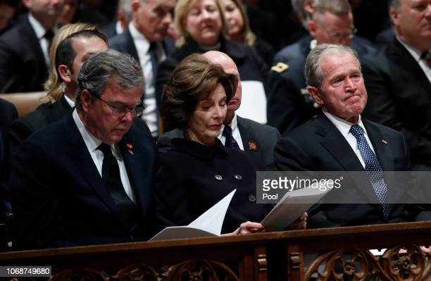 Former President George W. Bush, right, former first lady Laura Bush and former Florida Gov. Jeb Bush attend the State Funeral for former President...