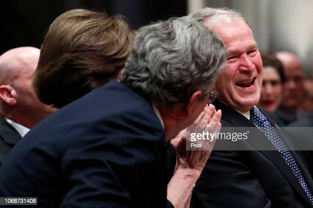 Former President George W Bush shares a moment with his brother Jeb Bush after speaking at the state funeral for their father former President George...