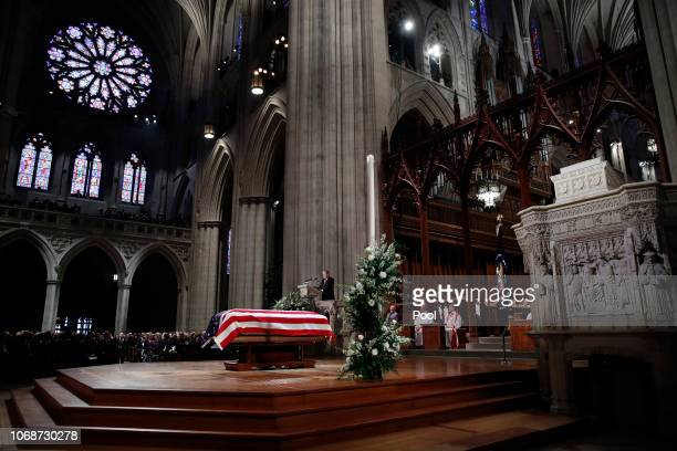 Former President George W Bush speaks in front of the flagdraped casket of his father former President George HW Bush at the State Funeral at the...