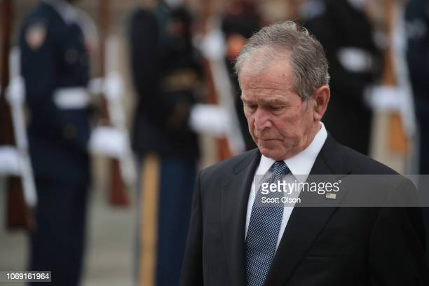 Former President George W Bush watches as the casket of his father President George HW Bush is carried from St Martin's Episcopal Church following...