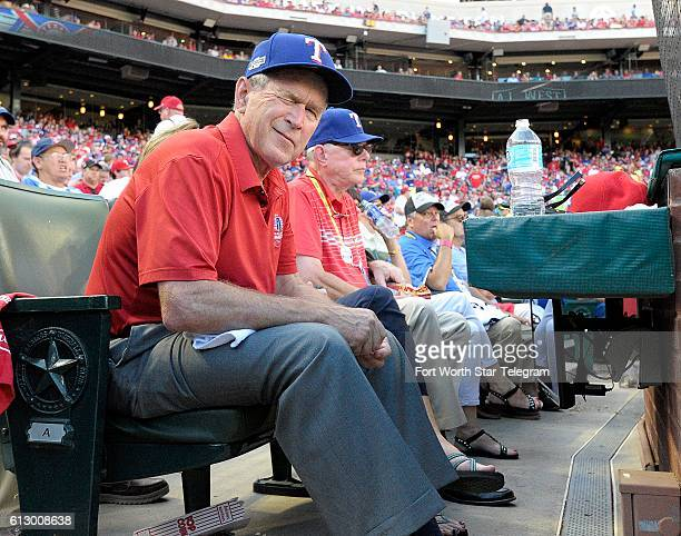 Former President George W Bush winks at the photographers as the Texas Rangers take on the Toronto Blue Jays in Game 1 of the ALDS at Globe Life Park...
