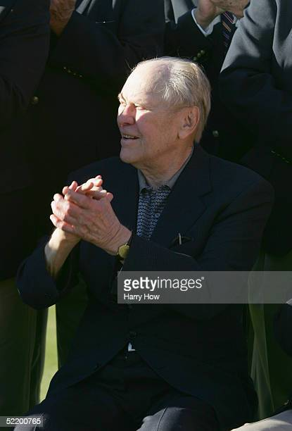 Former President Gerald Ford applauds during the final round of the Bob Hope Classic at the PGA West Palmer Course on January 30 2005 in La Quinta...