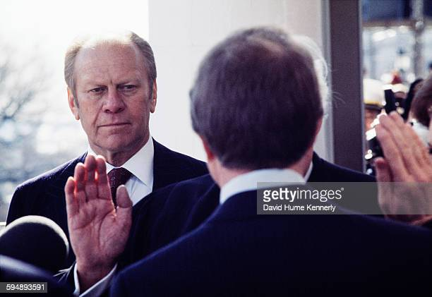Former President Gerald Ford looks on as the newly elected President Jimmy Carter takes his oath of office on the East Portico of the US Capitol,...