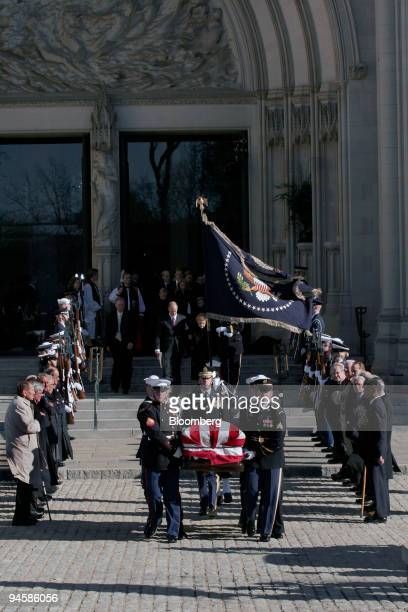 Former President Gerald Ford's casket departs the National Cathedral after his state funeral January 2 2007 in Washington DC Americans paid tribute...