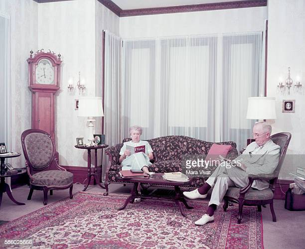 Former president Harry Truman and his wife Bess read in the living room of their home After his presidency ended in 1953 Truman retired to his...