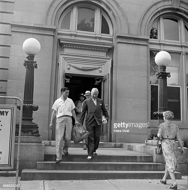 Former president Harry Truman converses with a man leaving a building at the same time After his presidency ended in 1953 Truman retired to his...