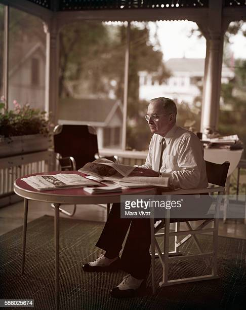Former president Harry Truman reads a newspaper on his screened back porch After his presidency ended in 1953 Truman retired to his hometown of...