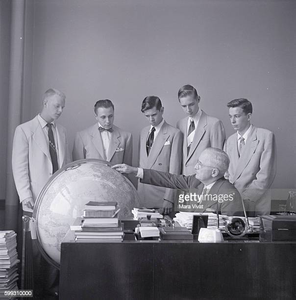 Former president Harry Truman shows his large globe to a group of teenage boys visiting his office After his presidency ended in 1953 Truman retired...