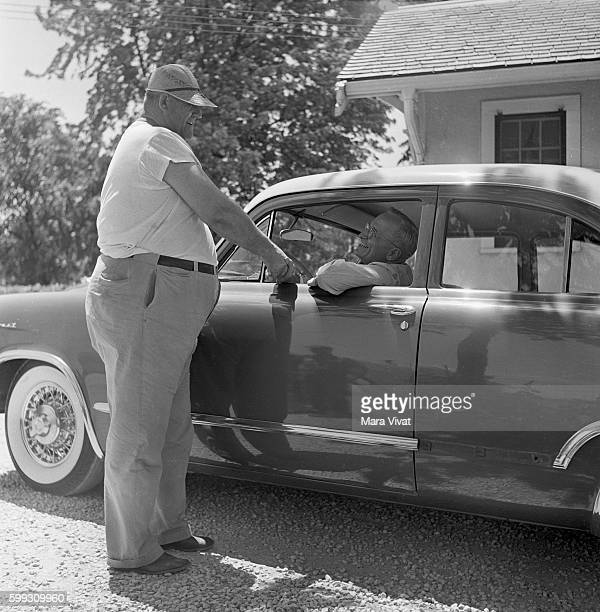 Former president Harry Truman stops his car to talk with a man on an Independence street After his presidency ended in 1953 Truman retired to his...