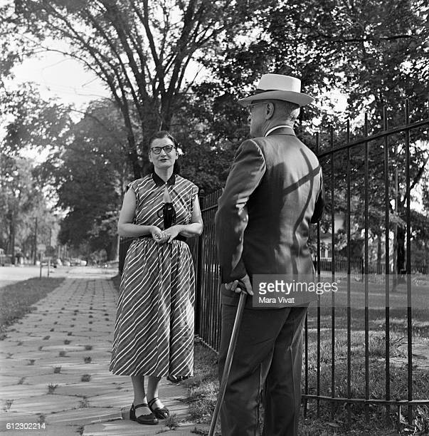 Former president Harry Truman talks to a woman on a stroll through a park After his presidency ended in 1953 Truman retired to his hometown of...