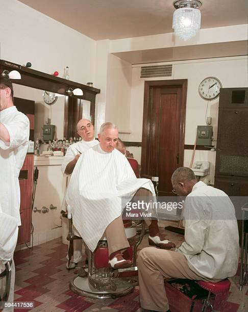 Former president Harry Truman visits a barbershop for a haircut and shoe shine After his presidency ended in 1953 Truman retired to his hometown of...