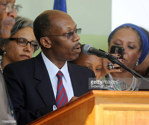 Former President Jean Bertrand Aristide speaks at a press conference in PortauPrince on March 18 2011 The return of Aristide after seven years of...