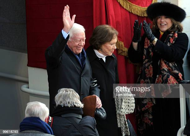 Former President Jimmy Carter and his wife Rosalynn arrive on the west front of the capitol for the 56th Inaugural where Barack Obama was sworn in as...