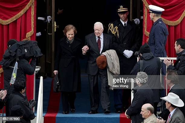 Former President Jimmy Carter and wife Rosalynn Carter arrive on the West Front of the US Capitol on January 20 2017 in Washington DC In today's...