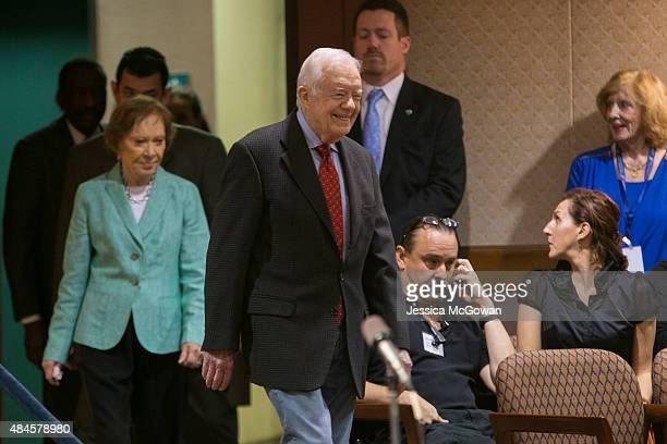 Former President Jimmy Carter arrives at a press conference with wife Rosalyn to discuss his cancer diagnosis at the Carter Center on August 20 2015...