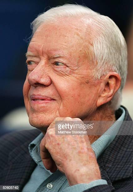 Former president Jimmy Carter attends the Atlanta Braves home opener against the New York Mets at Turner Field on April 8 2005 in Atlanta Georgia