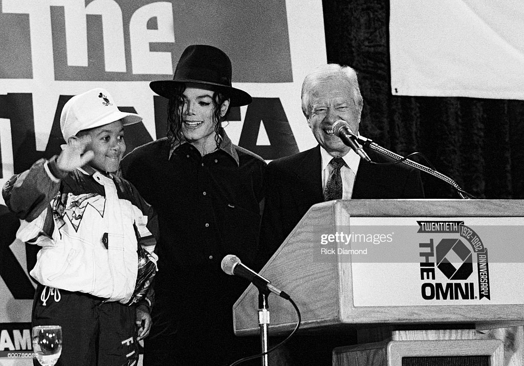 Former President Jimmy Carter, co-chairman of the Heal Our Children/Heal The World initiative with Michael Jackson, invites Michael Jackson to visit Atlanta to boost the Atlanta Projects Immunization Drive. Afterwards, Michael joins Jimmy Carter and actor Emmanuel Lewis at The Omni Coliseum in Atlanta Georgia. May 5, 1993