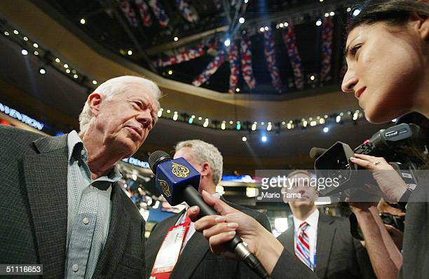 Former President Jimmy Carter is interviewed by Al Jazeera reporter Sanaa Hammoud on the convention floor for the opening session of the Democratic...