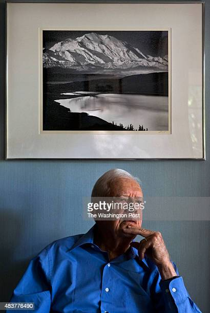 Former President Jimmy Carter ponders a question seated beneath an Ansel Adams photograph in his living room during his interview with October 2010...