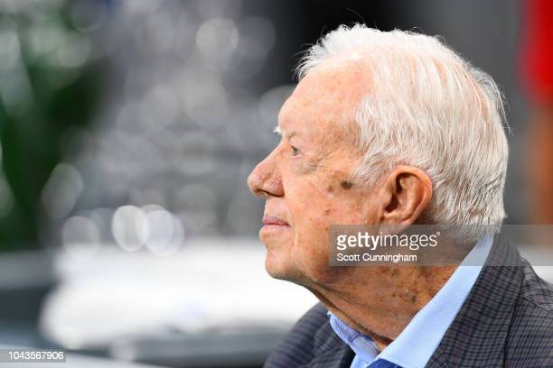 Former president Jimmy Carter prior to the game between the Atlanta Falcons and the Cincinnati Bengals at MercedesBenz Stadium on September 30 2018...