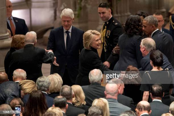 Former President Jimmy Carter second from left and former first lady Rosalynn Carter left greet former President Bill Clinton third from left as his...
