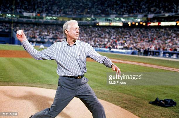 Former President Jimmy Carter throws out the ceremonial first pitch before Game One of the 1992 World Series between the Atlanta Braves and the...