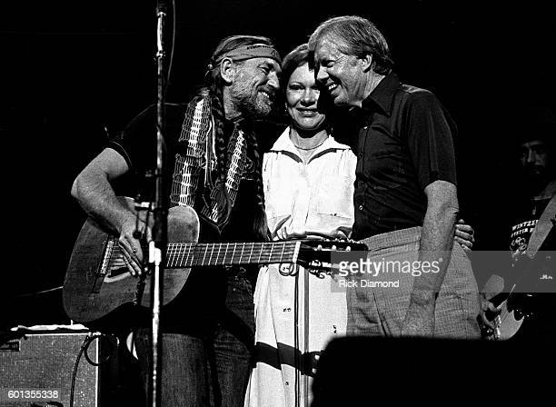 Former President Jimmy Carter with Former First Lady Rosalynn join Willie Nelson and perform at The Omni Coliseum in Atlanta Georgia December 12 1982