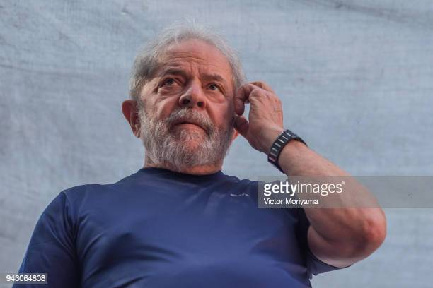 Former President Luiz Inacio Lula da Silva gestures to supporters at the headquarters of the Metalworkers' Union where a Catholic mass was held in...