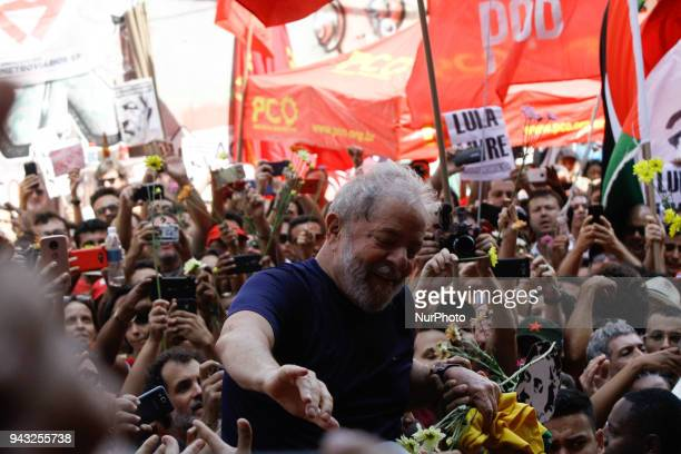 Former President Luiz Inacio Lula da Silva with impeached former president Dilma Rousseff gestures to supporters at the headquarters of the...