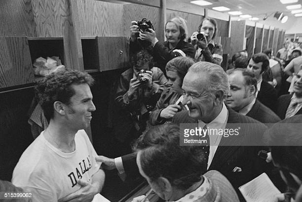 Former President Lyndon B Johnson congratulates winning quarterback Roger Staubach in the Dallas Cowboys dressing room following the National...