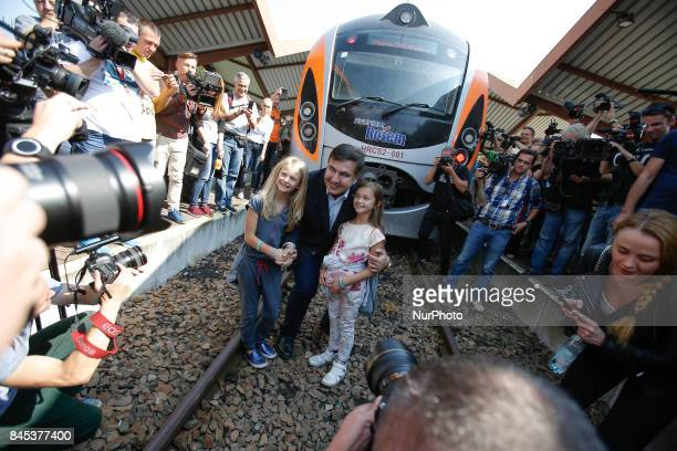 Former president Mikheil Saakashvili is seen posing for photos in front of the train to Lviv at Przemysl train station on 10 September 2017 Mister...