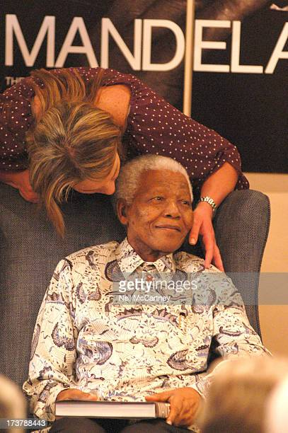 CONTENT] Former President Nelson Mandela and his PA Zelda La Grange share a moment during the international launch of Mandela the Authorised Portrait...