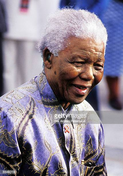Former president Nelson Mandela arrives at a ceremony on February 11 2004 in Cape Town South Africa Mandela attended a ceremony celebrating the first...